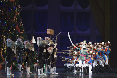 Scene from the Nutcracker Mice standing at attention in front of soldiers bearing swords