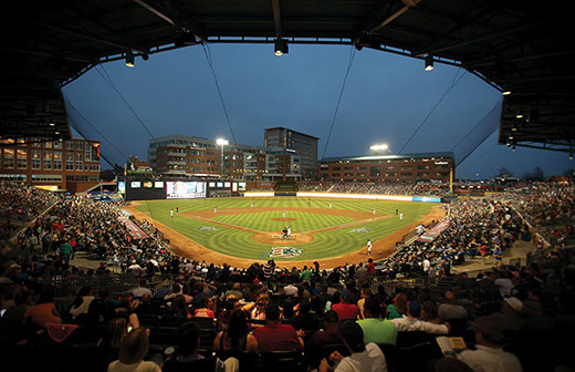 Durham Bulls Athletic Park stadium seating with field lit up at night