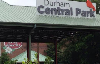 Durham Central Park Signage on top of Green metal roof