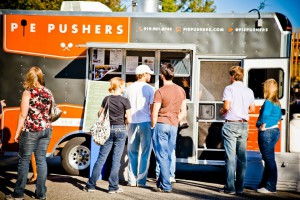 Pie Pushers Food truck with people at the window ordering