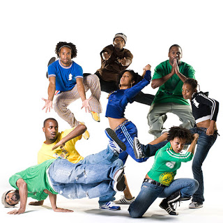 Dancers in various break dancing poses
