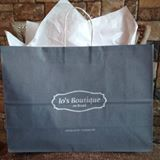 grey shopping bag with Joe's Boutique logo
