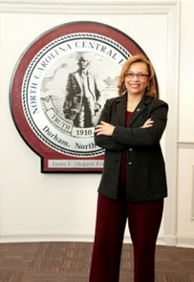 Woman standing in front of the North Carolina Central emblem