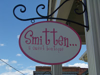 Smitten Boutique Sign with sky in the background