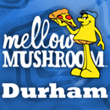 Mellow Mushroom Durham with mushroom character holding a slice of pizza
