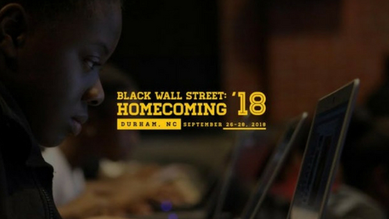 black wall street homecoming Durham, NC 2018, person looking at laptop screen