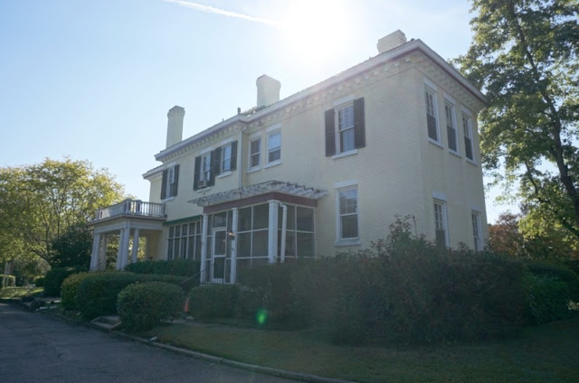 Side view of Morehead Manor a Colonial Revival Styled Inn built in 1910 with sun shining over the roof