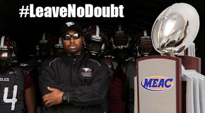 NCCU Football coach with MEAC conference trophy
